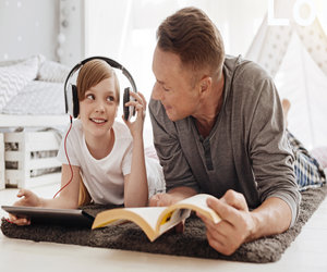 Child Ear Reading With Parent